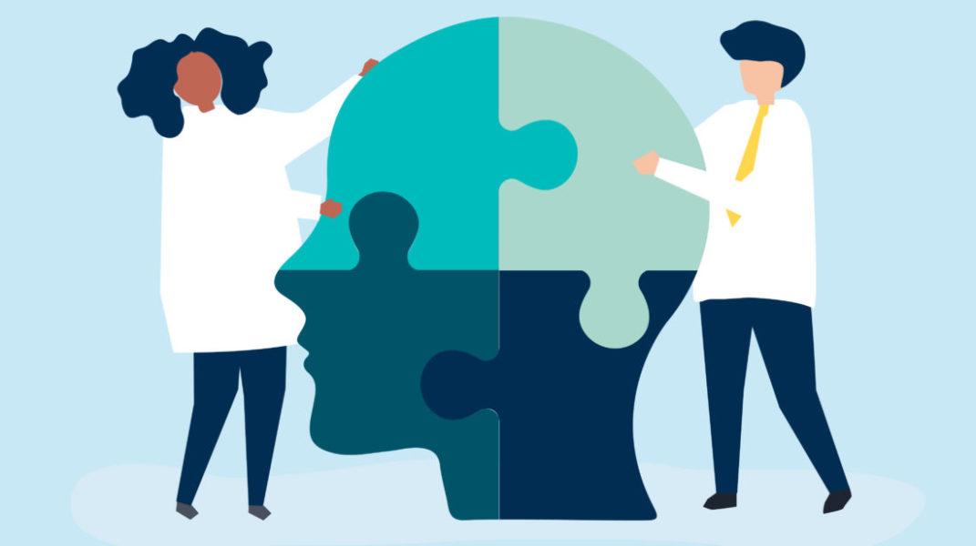 Duas Pessoas Montando Um Quebra-cabeça No Formato De Uma Cabeça Representando O Cuidado Com A Saúde Mental